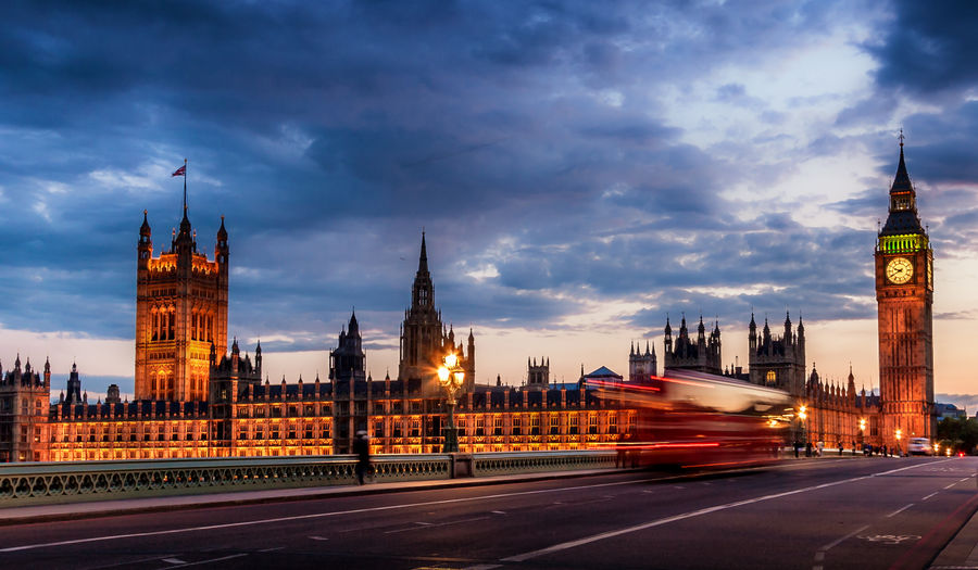 Houses Of Parliament And Big Ben Against Cloudy Sky During Sunset