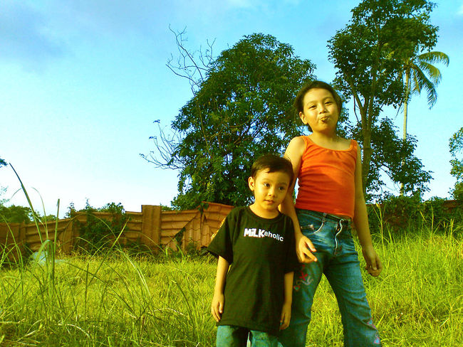children wander at a vacant lot Casual Clothing Child Children Day Field Grass Grassy Outdoors Siblings Smiling Trees Vacant Lot