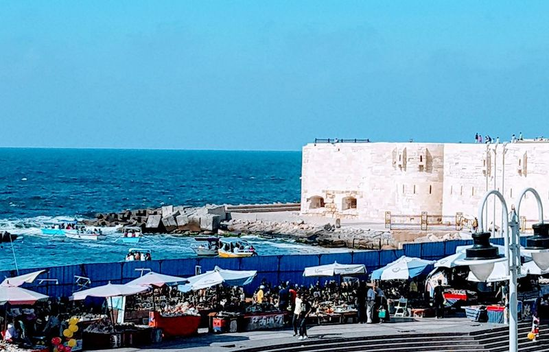Alexandria city , Egypt Water Sea Beach City Clear Sky Blue Sky Horizon Over Water Architecture Building Exterior Beach Umbrella Beach Holiday Sand Thatched Roof