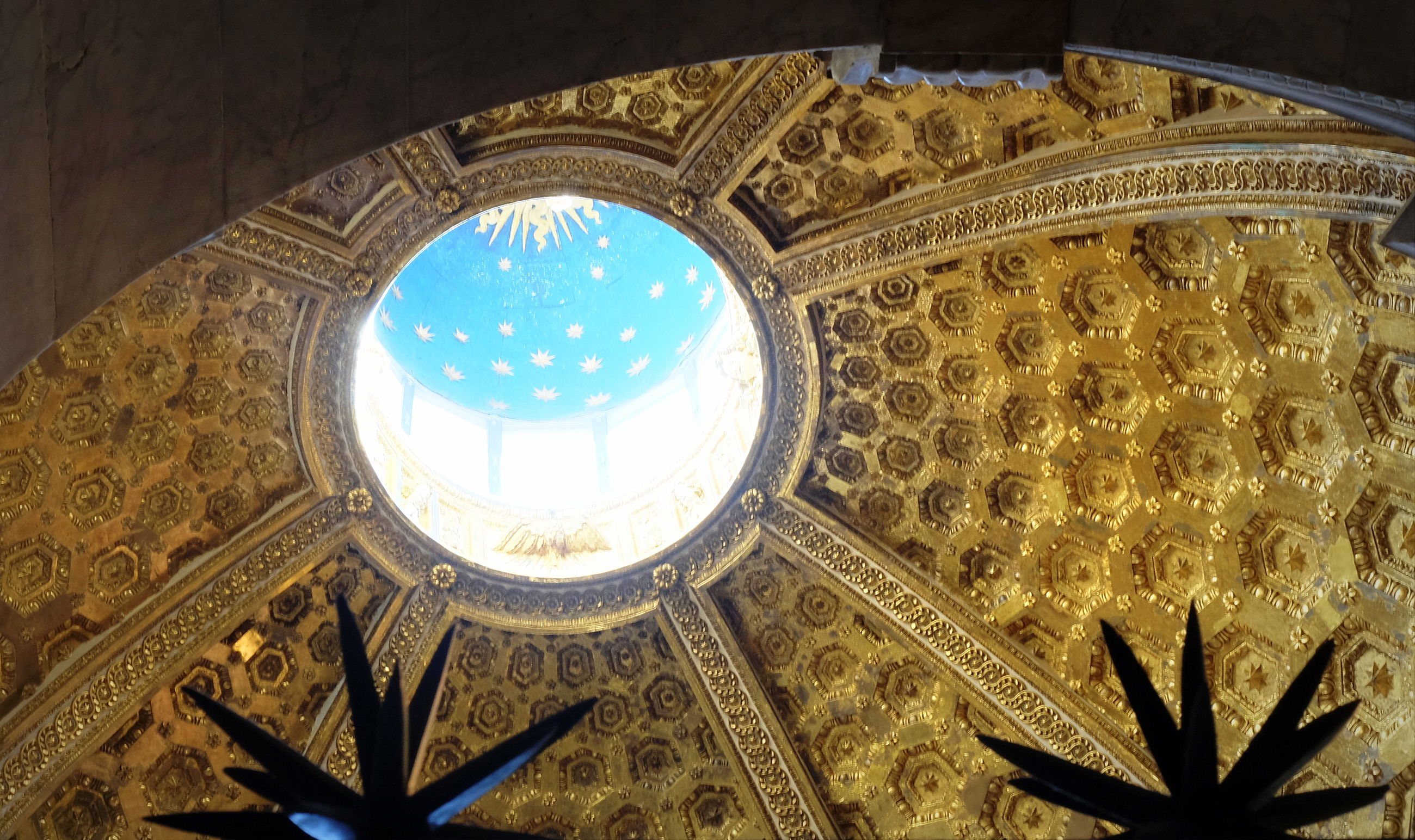 low angle view, built structure, architecture, ceiling, indoors, pattern, dome, building, design, no people, ornate, art and craft, place of worship, religion, belief, craft, creativity, cupola, lighting equipment, architecture and art, directly below, mural