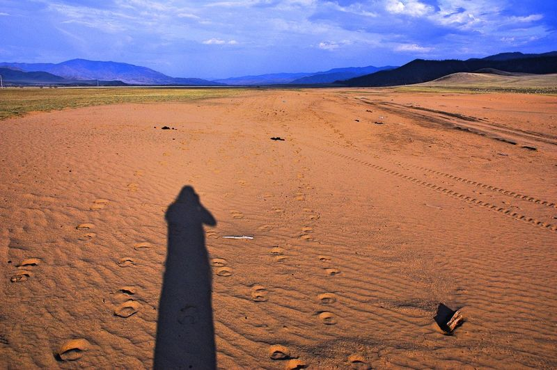Shadow Of Person On Desert