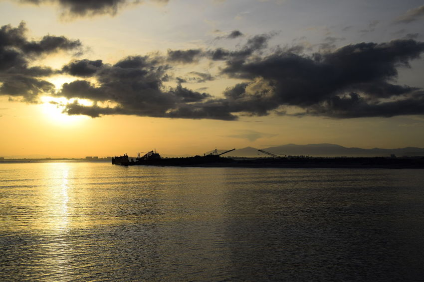 Sunrise over reclamation ground on sea. Sunrise Water Sea Beauty Silhouette Reflection Sky Horizon Over Water Landscape