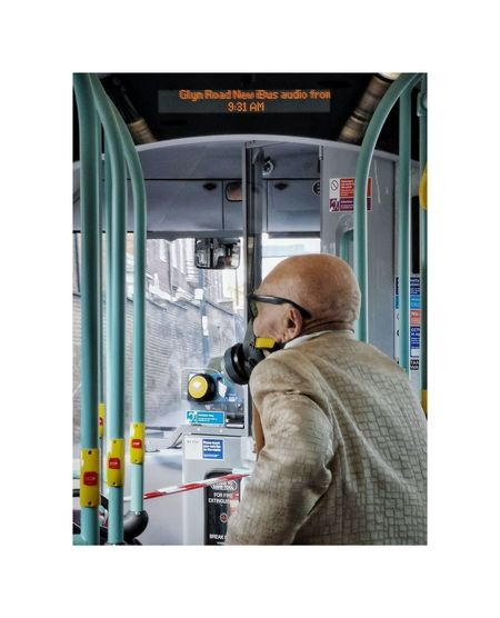 Rear view of man working in bus