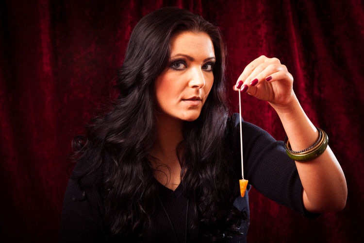 Psychic reading your future Fortune Telling Witchcraft  Brunette Charlatan Clairvoyance Forecast Fortune Teller Future Indoors  Magic Magick Medium One Person Pendulum People Psychic Psychic Medium Witch Women Young Adult