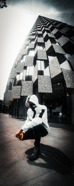 Side view of man dancing in city