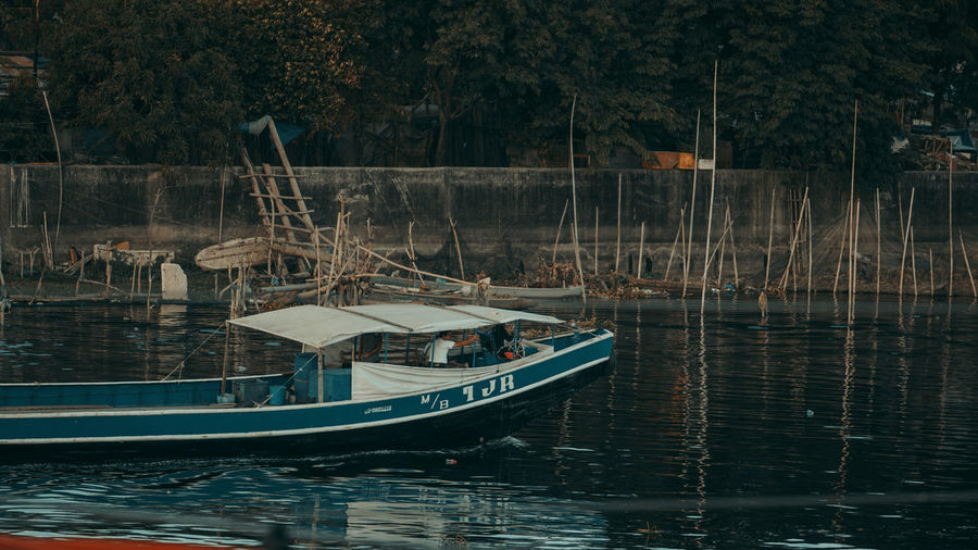 Fishing boats moored in lake