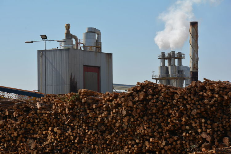 Architecture Building Exterior Built Structure Chimney Day Factory Heap Industry Low Angle View Outdoors Pollution Sky Smoke Stack Trunks Wood