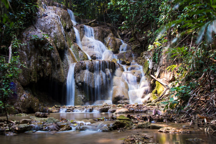 Chiang Rai, Thailand Beauty In Nature Blurred Motion Chiangrai Day Flowing Water Forest Hot Spring Long Exposure Motion Nature No People Outdoors Plant Power In Nature Pu Kang Waterfall Rock - Object Stream - Flowing Water Tourism Travel Travel Destinations Tree Vacations Water Waterfall