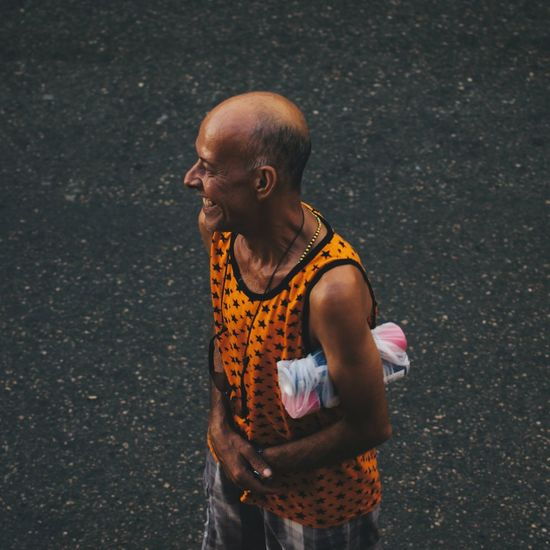 High angle view of man looking away on street