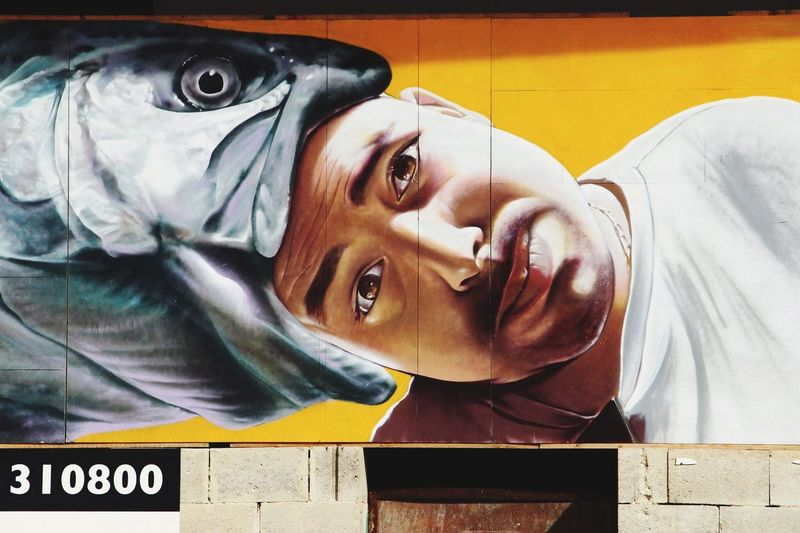 Street view Murales Streetart Colors Fish Man Malta Valletta,Malta Valletta