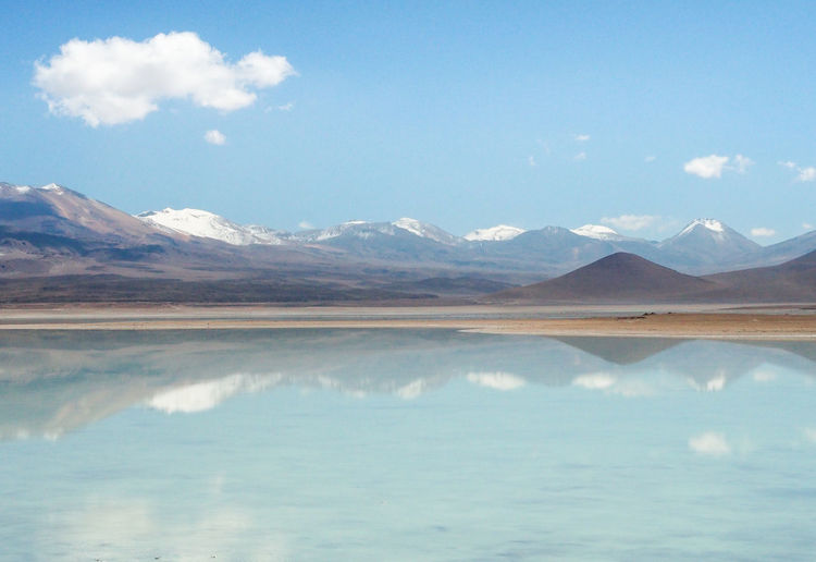 Bolivian desert Beauty In Nature Cloud - Sky Day Environment Lake Landscape Mountain Mountain Peak Mountain Range Nature No People Non-urban Scene Outdoors Range Reflection Salt Flat Scenics - Nature Sky Tranquil Scene Tranquility Water Waterfront