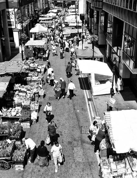 Architecture Building Building Exterior Built Structure City City Life City Street Day Fruit Hot Sunny Day Leisure Activity Lifestyles Market Market Stall Outdoors People Residential Building Street Streetphoto_bw High Contrast Busy Street No Cars In This Picture Blackandwhite Photography Black & White Enjoy The New Normal