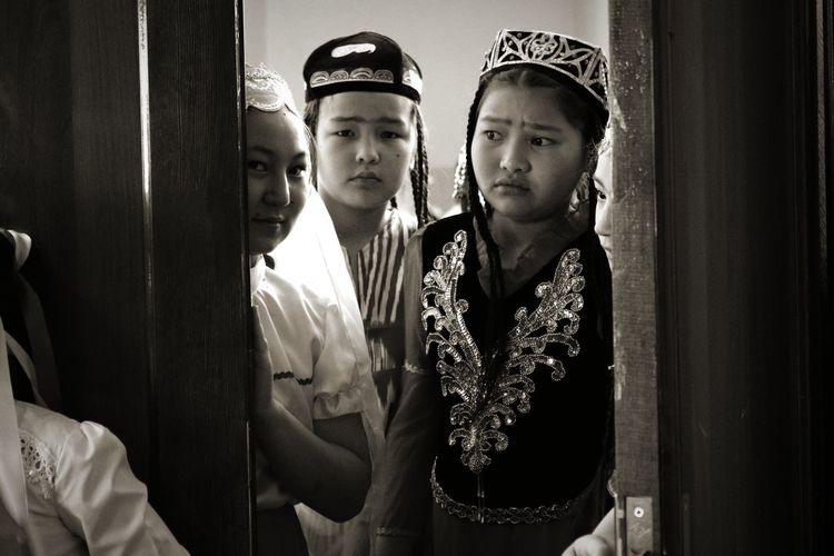 Children Wearing Costumes Standing On Doorway