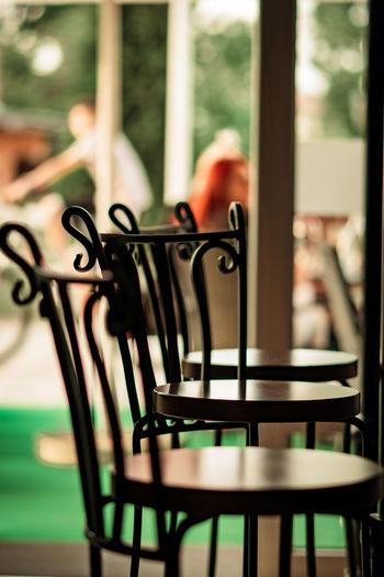 Empty chairs in restaurant