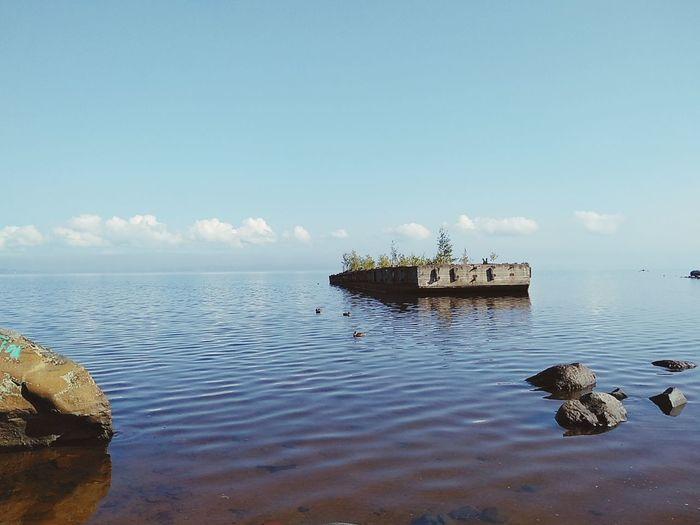 View of groyne in sea against sky