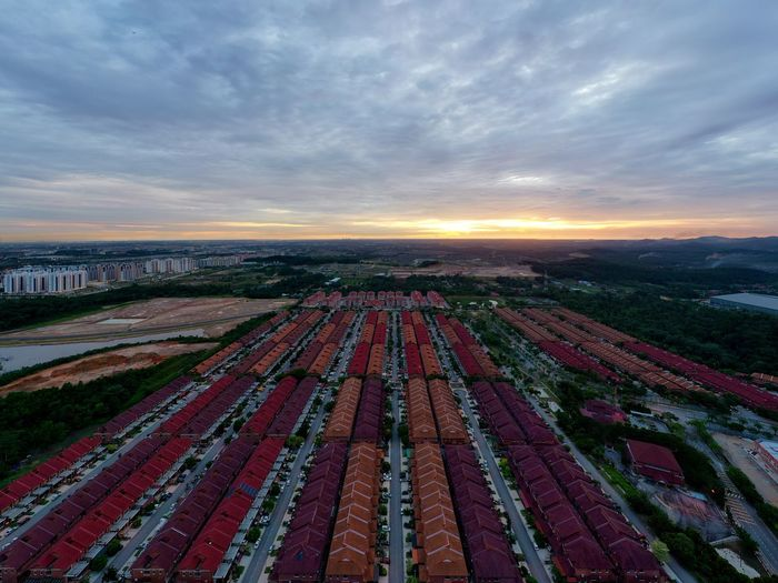 High angle view of field against sky during sunset