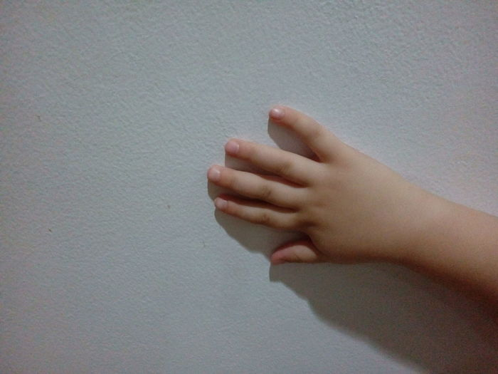 Child's Hand On The Wall Child's Hand White Wall Hand Jakarta Indonesia Human Body Part Human Hand One Person Childhood Human Finger Real People Human Skin Close-up Indoors  Child Day Low Section People
