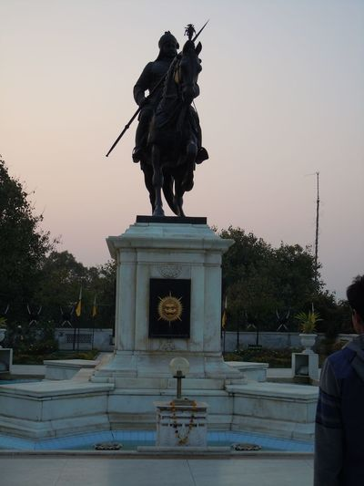 00933 Moti Magari, Udaipur-The statue of Maharana Pratap Architecture Art Art And Craft Built Structure City Life Creativity Culture Façade Famous Place History Horse Human Representation In Front Of Incidental People Low Angle View Memories Monument Outdoors Pedestal Sculpture Sky Statue
