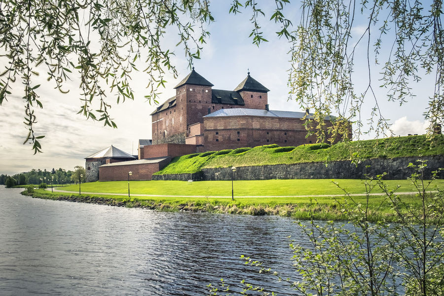 Scenics landscape with old Hame Castle in Hämeenlinna, Finland Architecture Barrier Branches Building Exterior Castle City Dandelion Day Grass Green Historic History Lake Landscape Light And Shadow Nature Nice Weather No People Old Buildings Outdoors Silver Willo Srping Tree Trees Wall