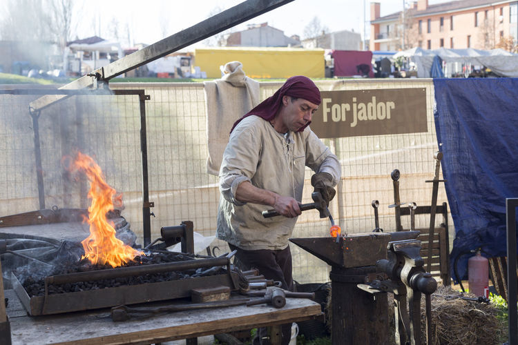 Medieval blacksmith Blacksmith  Culture Cultures Handmade Medieval Old Buildings Person Professional Traditional Work Worker Working Working Hard