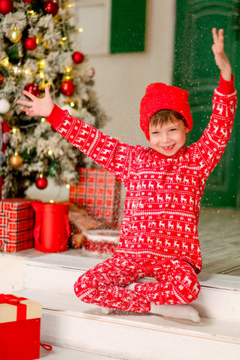Boy with christmas tree in winter