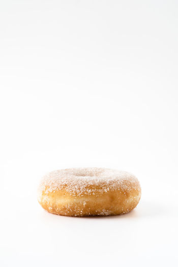 single donut on white background with copy space   daylight food photography Studio Shot White Background Food And Drink Food Close-up No People Copy Space Donut Sweet Food Single Object Baked Indulgence Simplicity Sweet Snack Copy Space Foodphotography Food Photography