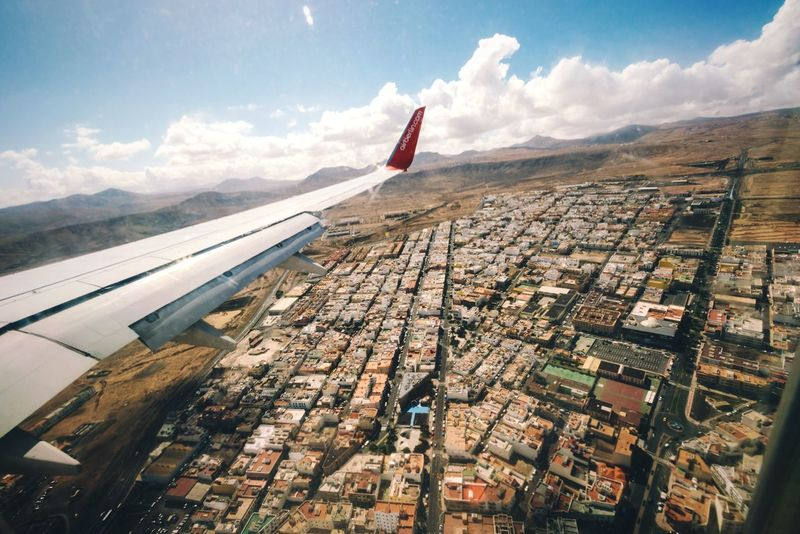 Desert town Sky Cloud - Sky Airplane No People Transportation Aerial View Flying Outdoors Built Structure Architecture Mountain City Airplane Wing Fuerteventura Canary Islands Puerto Del Rosario SPAIN Volcanic Landscape Desert Landing Neighborhood Map View From Above Droneshot View From The Window... Cityscape