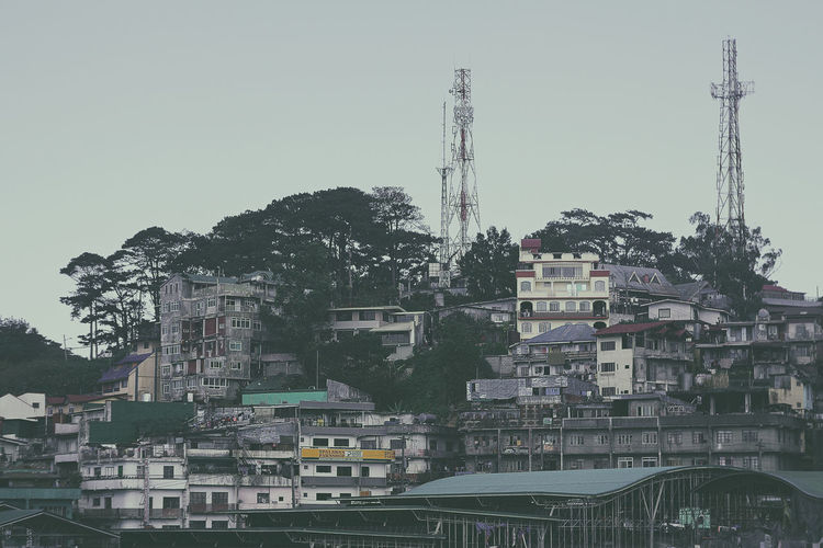 Urban decay. Architecture Baguio Building Building Exterior Built Structure City Cityscape Clear Sky Connection Day Industry Nature No People Outdoors Plant Residential District Sky Tall - High Thirdworld Tower Tree Urban Skyline