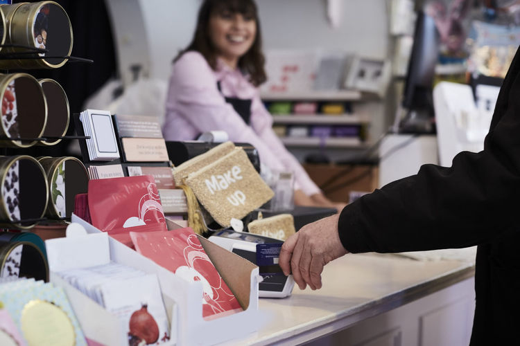 Woman holding ice cream at store