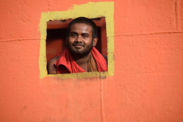 Portrait Of Smiling Man Seen Through Window