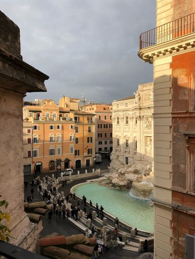 Trevi Fountain from a particular perspective Rome At Sunrise Roma All'alba Alba Sunrise Fontana Di Trevi Barocco Roof Particular Position Trevi Fountain Fountain Building Exterior Built Structure Architecture Sky City Building Cloud - Sky Incidental People
