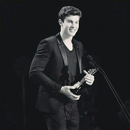 It's my idol Shawn Mendes Music Only Men One Man Only Musician Artist Occupation People Black Background Portrait Singer  Event Plucking An Instrument Musical Instrument Performance Arts Culture And Entertainment Men Shawnmendes  Shawn Mendes AWARD Awards Rock Music Smile Black Blackandwhite Black And White