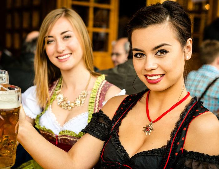 Young woman havig fun on the Oktoberfest in Munich Alcohol Attractive Beer Beer Festival Brezel Dirndl Event Fun Lifestyles Munich München Oktoberfest Party Partying Tracht Trachten Woman Woman Portrait Women Young Women
