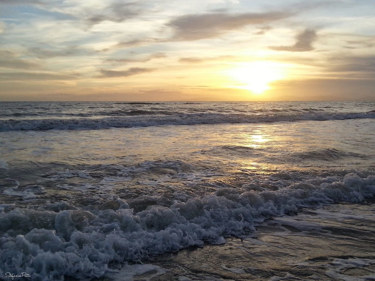 sunset, sea, beauty in nature, nature, beach, wave, water, scenics, shore, sun, sky, tranquility, tranquil scene, horizon over water, no people, outdoors, sand, cloud - sky, sunlight, motion, day