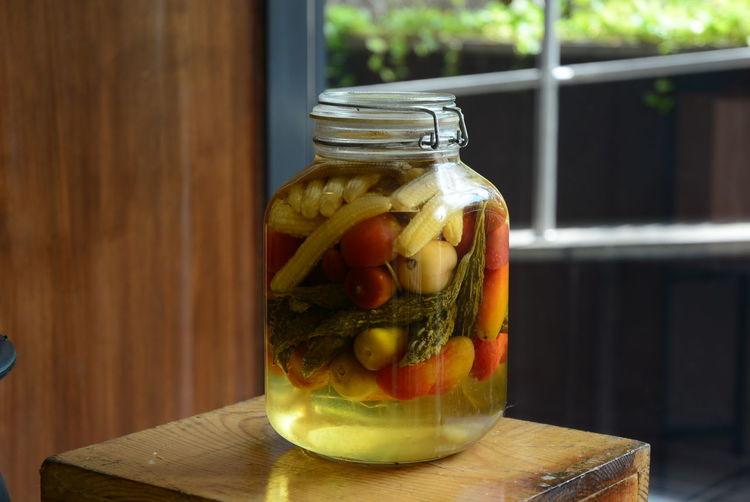 Pickled jar on stool
