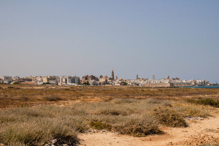 Monopoli Adriatic Coast Architecture City City In The Desert Cityscape Clear Sky Dry Grass Heat Italy Landscape No People Outdoors Sky Small City