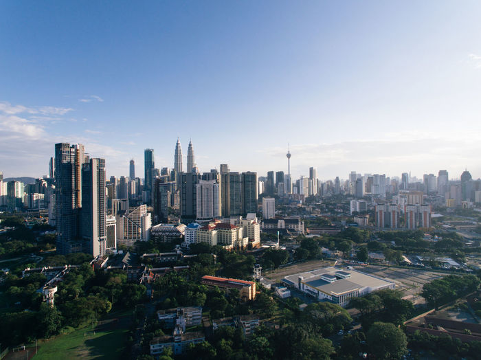 Kuala Lumpur city skyline in evening view ASIA Atmosphere Kuala Lumpur Architecture Building Exterior City Cityscape Clouds Crowded Day Development Evening Growth High Angle View Infrastructure Landscape Malaysia Sky Skyline Skyscraper Sun Tall Tower Travel Destinations Urban Skyline