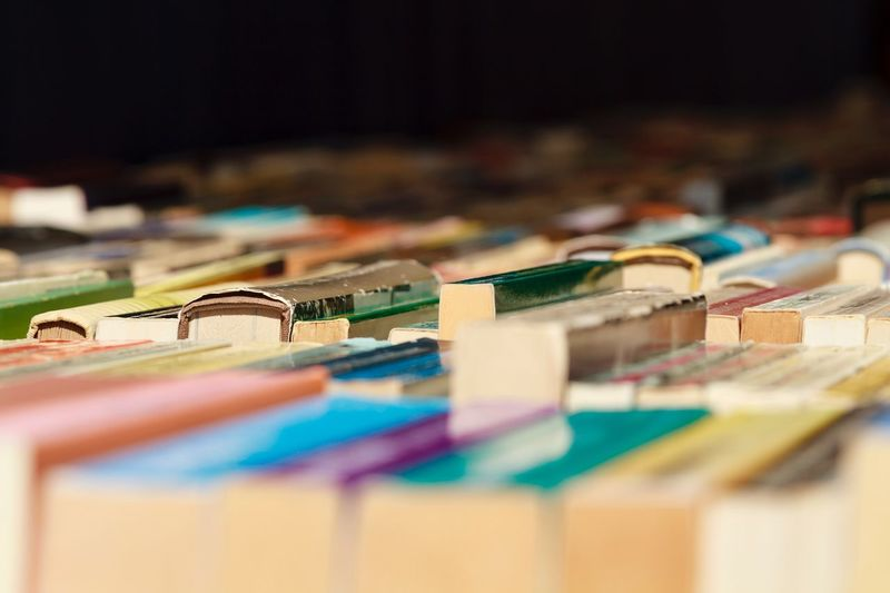 Close-up of multi colored books in row