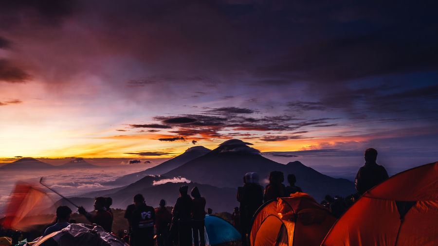 Group of people on mountain during sunset