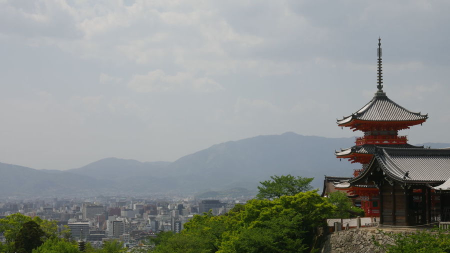 Kiyomizu Dera Temple By Cityscape Against Mountains