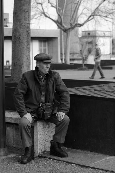 Oldman Oldstreets Sadness Streetphotography Thinking Black&white City Life Blackandwhite Citybench Bench Busstop Everyday Emotion The Street Photographer - 2018 EyeEm Awards Park Bench Flat Cap Thoughtful Wearing