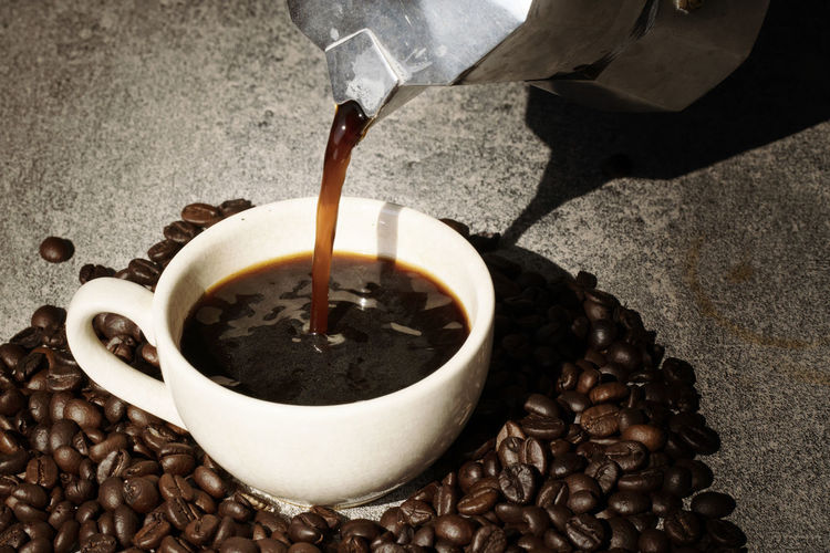 Coffee pouring to cup with coffee bean on black background Food And Drink Coffee Drink Refreshment Coffee - Drink Pouring Freshness Food Cup Coffee Cup Mug Roasted Coffee Bean Still Life Indoors  High Angle View Close-up No People Brown Hot Drink Caffeine