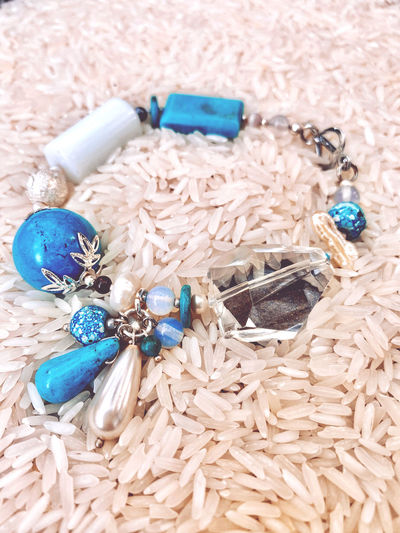 High angle view of bracelet on rice