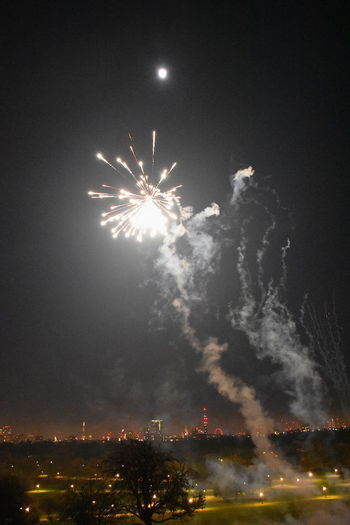 Primrose Hill London Arts Culture And Entertainment Blurred Motion Bonfire Night Building Exterior Built Structure Celebration City Cityscape Event Exploding Exploding Fireworks Firework Firework - Man Made Object Firework Display Illuminated Illuminated Night Motion New Year Eve Night No People Outdoors Primerose Hill Sky Smoke - Physical Structure