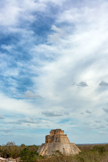 Vertical view of the House of the Magician in Uxmal, Mexico with a dramatic sky Ancient Archaeology Architecture City Mayan Mayan Ruins Mexico Pyramid Riviera Maya Ruins Uxmal Uxmal Mexico Yúcatan America Building Civilization Culture Destination Maya Mexican Monument Riviera Stone Temple Tourism