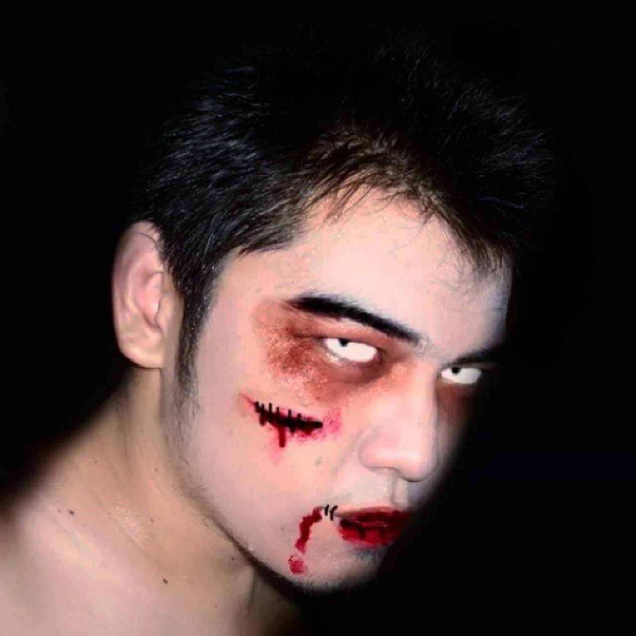 physical injury, blood, wound, human blood, beaten up, black background, red, studio shot, make-up, pain, one man only, people, adult, portrait, adults only, human body part, only men, one person, looking at camera, human face, close-up, one young man only, young adult
