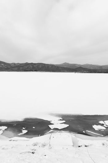 black and white image of snow-covered lake, Uiamho Lake in Chuncheon, Gangwondo, South Korea Black & White ChunCheon Cold Lake Cold Weather Gongjicheon Snow Land Uiamho Lake Winter Winter Landscape Beauty In Nature Black And White Blackandwhite Bw Cold Cold Temperature Day Frozen Ice Lake Landscape Mountain Nature No People Outdoors Reflection Salt - Mineral Salt Flat Scenics Sky Snow Snow-covered Snow-covered Lake Tranquil Scene Tranquility Water Winter Winter Lake Winter Land Winter Time
