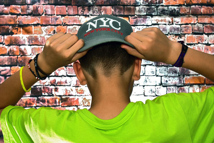 Rebel Brick Wall Human Body Part Human Hand People Headshot One Person Adults Only Only Men Adult One Man Only Men Real People Photography Themes Day Indoors  Wireless Technology Selfie Close-up Photo Messaging Young Adult Cap Urban Lifestyle Rebel New York Urban Tribe