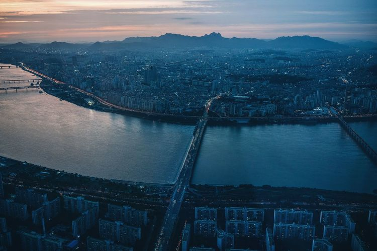 What a view Riverside City Life Skyline Cyberpunk Urban Skyline Metropolis View From Above Cityscape Seoul Sky Han River Illumination Illuminated Lotte World Tower Korea Seoul Architecture Built Structure Bridge - Man Made Structure High Angle View River Cityscape Travel Destinations City Sky Outdoors No People Water Aerial View Mountain Sunset