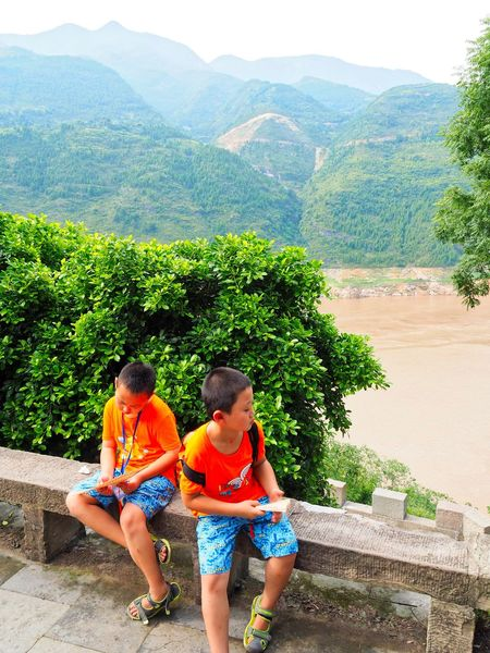 Twins China Photos Environmental Portraits Holiday Sitting Outside Summer Views Travel Photography Twin Boys Yangtze River Beauty In Nature Children Only Day Growth Males  Men Mountain Mountain Range Nature On The Horizon Outdoors People Scenics - Nature Taking A Rest  Tourist Destination Two People Young Boys